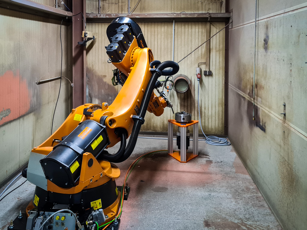 Roboterzelle zum thermischen Spritzen mit Drehpositionier